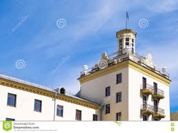 yellow dwelling house with tower and balcony stock photo image