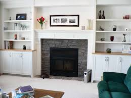 interior stone fireplace with white fireplace mantels and wall