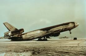 an abandoned world airways dc 10 airplane sitting on its tail