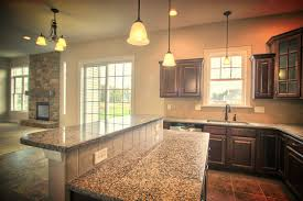the large open kitchen with adjoining breakfast area includes an