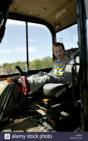 jcb jcb for children jcb small red haired ginger male child boy sitting in cab or cockpit