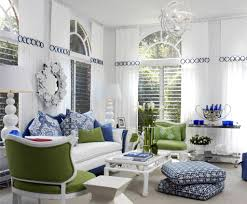 white modern living room with stylish furniture with green and