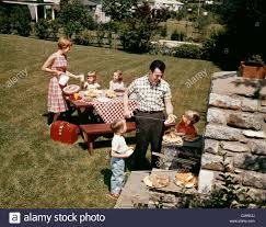 1960s family father mother two daughters two sons backyard bar b