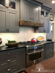 gray kitchen cabinets with black counter gray cabinets black counters slate herringbone floor marble hex