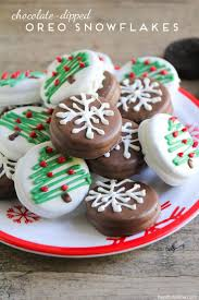 these chocolate dipped oreo snowflakes and christmas trees are so