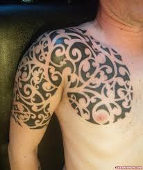 tribal tattoo on man chest and left shoulder tattoo viewer com