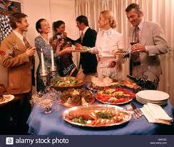 1970s men women cocktail dinner party buffet woman hostess serving