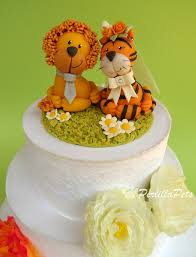 lion cake topper and tiger cake topper on a wedding cake perlilla pets flickr