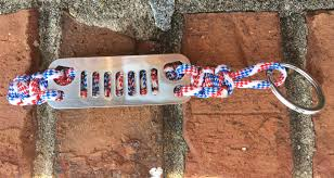white and blue jeep jeep grille paracord keychain in red white and blue