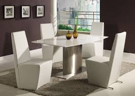 minimalist white dining room table with nice modern chairs