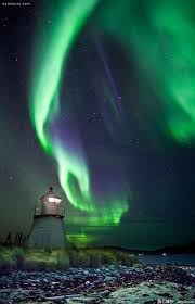 norway northern lights hotel aurora borealis over lighthouse skittenelv norway amazing