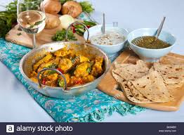 dips cuisine table with typical indian dishes such as indian curry roti and
