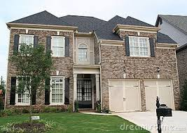 brown brick with tan accents and black shutters new house