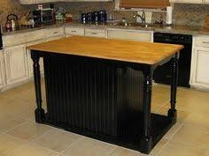 rolling island kitchen how to turn a table into a rolling island great for laundry
