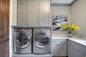 Laundry Room Storage Between Washer And Dryer Built In Washer Dryer Platform Contemporary Laundry Room