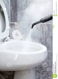 cleaning a toilet with steam royalty free stock photos image