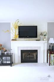 tv above fireplace too high where to put cable box stand costco tv