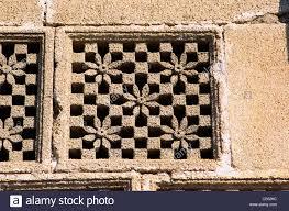stone carved grill window jali in rukshmani temple dwarka gujarat