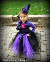 witch costume tutu dress top hat headband and striped leg warmer