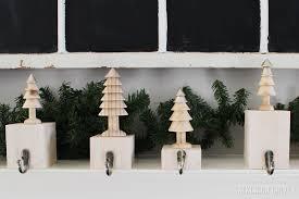 decorating metallic christmas stocking hanger on faux wooden