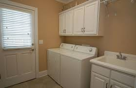 Hampton Bay Cabinets Traditional Laundry Room With Built In Bookshelf U0026 Louvered Door