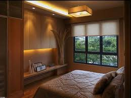 small bedrooms ideas modern beige wall dark wood bed headboard 25