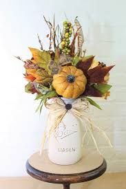 jar floral centerpieces fall brown and gold jar floral arrangement gold jars