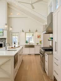 white kitchen cabinets with oak floors prefinished white oak floors in a welcoming new hshire