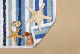 starfish towel seashore background with starfish and towel stock photo