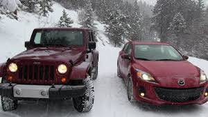 mazda 3 4x4 2013 mazda3 vs jeep wrangler snowstorm winter tire mashup test