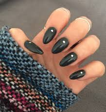 long dark gray almond shaped nails with silver dot design super