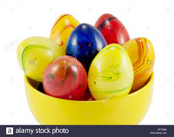 ceramic easter eggs ceramic easter eggs in the yellow bowl on a white background stock