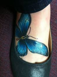 blue butterfly on design of tattoosdesign of tattoos