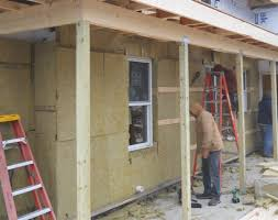 wrapping an older house with rock wool insulation