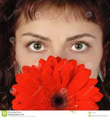 funny teen holding daisy flowers at her eyes royalty free