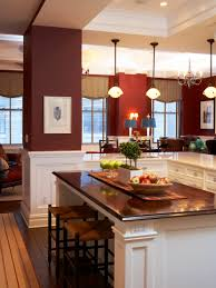 transitional kitchen with dark red walls white painted wood work