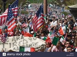crowds of demonstrators mostly hispanic wave american and mexican