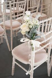 ceremony chair flowers winter wedding flowers aisle decoration