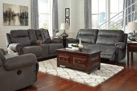 2 seat reclining sofa with rolled arms and nailhead trim by