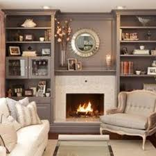 Living Room Storage Cabinets Beside Fireplace Google Search - Family room storage cabinets