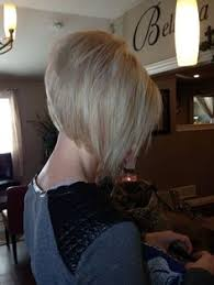 styling a sling haircut auburn asymmetrical sling bob with peek a boo pink panels by
