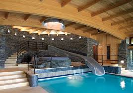 pool inside house wood stone and glass make for a space as beautiful as it is
