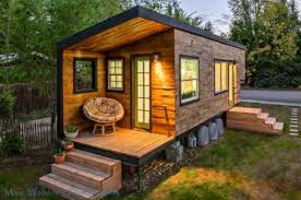 mobile cabins go off grid in these 12 rustic modern designs