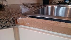 Damaged Kitchen Cabinets Granite Tile Can Be Reaffixed To Countertop Edge Tribune Content