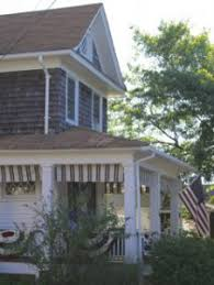 beautiful bright ocean grove victorian with pretty porch and patio