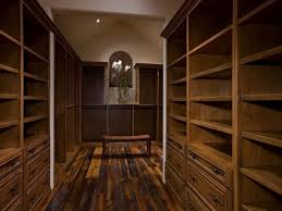 craftsman closet with built in bookshelf hardwood floors