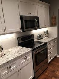 Tile For Backsplash In Kitchen by Fantasy Brown Granite With Backsplash Sw Repose Gray Paint