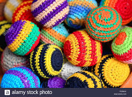 typical nepalese made manycolored crochet woolen balls for