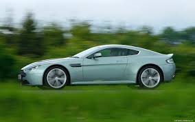 green aston martin cars desktop wallpapers aston martin v12 vantage hardly green 2009