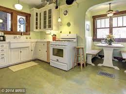 cottage kitchens ideas three red polished iron stools on tiles floors country cottage